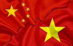 Bandiera della Cina e bandiera del Vietnam Fotografia Stock