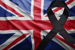Bandiera della Gran Bretagna con il nastro di dolore nero Immagini Stock Libere da Diritti
