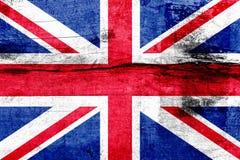 Bandiera della Gran Bretagna dipinta su un bordo di legno stagionato Bandierina del Regno Unito Priorità bassa astratta struttura Immagine Stock Libera da Diritti