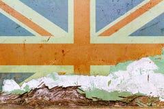 Bandiera della Gran Bretagna dipinta su un muro di cemento Bandierina del Regno Unito Priorità bassa astratta strutturata Fotografia Stock