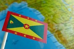 Bandiera della Granada con una mappa del globo come fondo Fotografia Stock Libera da Diritti