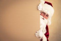 Bandiera della holding del Babbo Natale Immagini Stock
