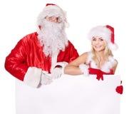 Bandiera della holding della ragazza di natale e del Babbo Natale. Immagini Stock