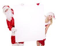 Bandiera della holding della ragazza e del Babbo Natale. Fotografia Stock