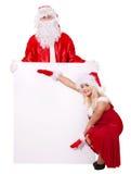 Bandiera della holding della ragazza e del Babbo Natale. Immagine Stock