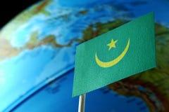 Bandiera della Mauritania con una mappa del globo come fondo Fotografia Stock Libera da Diritti