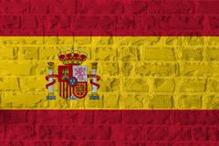 Bandiera della Spagna sul fondo di struttura del muro di mattoni Immagine Stock