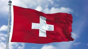 Bandiera della Svizzera in un cielo blu fotografia stock libera da diritti