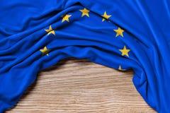 Bandiera di Europa su fondo di legno Fotografia Stock