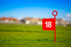 Bandiera di golf del foro di rosso 18 Fotografia Stock