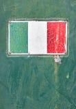 Bandiera di Italan sul vecchio piatto Immagine Stock
