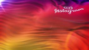 Bandiera di logo di Instagram che ondeggia sul sole Ciclo senza cuciture con il textur altamente dettagliato del tessuto video d archivio