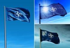 Bandiera di NATO che ondeggia sul vento fotografia stock