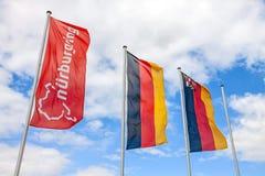 Bandiera di Nurburgring e bandiere tedesche al palo Fotografia Stock Libera da Diritti