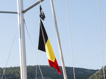 Bandiera di pirata e del Belgio immagini stock