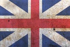 Bandiera di Union Jack sulla parete bianca immagine stock