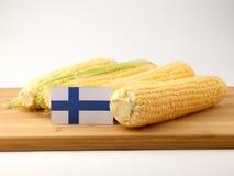 Bandiera finlandese su un pannello di legno con cereale isolato su un BAC bianco Immagine Stock Libera da Diritti