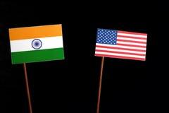 Bandiera indiana con la bandiera di U.S.A. sul nero fotografia stock
