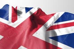 Bandiera isolata del Regno Unito che ondeggia il tessuto realistico di 3d Regno Unito Fotografie Stock