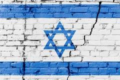 Bandiera israeliana dipinta su un muro di mattoni Bandierina dell'Israele Priorità bassa astratta strutturata Fotografie Stock Libere da Diritti