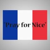 Bandiera nazionale della Francia La frase prega per Nizza scritta Fotografie Stock
