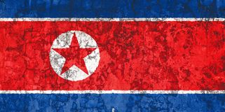 Bandiera nazionale sui precedenti di vecchia parete fotografia stock libera da diritti