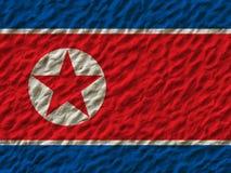 Bandiera nordcoreana sulla parete fotografie stock