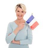 Bandiera senior della Francia della donna immagini stock