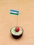Bandiera su un bigné della mela, l'Uzbekistan Fotografie Stock