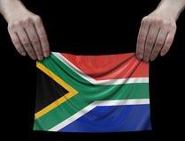 Bandiera sudafricana della repubblica in mani fotografie stock