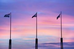 Bandiere al tramonto Immagine Stock