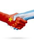 Bandiere Cina, paesi dell'Argentina, concetto della stretta di mano di amicizia di associazione illustrazione 3D Fotografie Stock