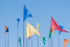 Bandiere colorate contro il cielo Fotografia Stock Libera da Diritti