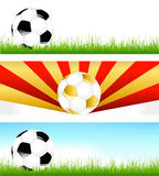 Bandiere con le sfere di calcio Fotografie Stock Libere da Diritti