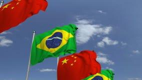 Bandiere d'ondeggiamento del Brasile e della Cina sul fondo del cielo, animazione loopable 3D video d archivio