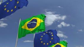 Bandiere d'ondeggiamento del Brasile e l'UE sul fondo del cielo, animazione loopable 3D stock footage