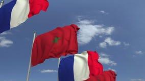 Bandiere d'ondeggiamento del Marocco e della Francia sul fondo del cielo, animazione loopable 3D stock footage
