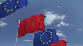 Bandiere d'ondeggiamento del Marocco e l'UE sul fondo del cielo, animazione loopable 3D stock footage