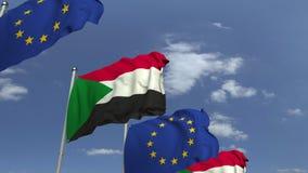 Bandiere d'ondeggiamento del Sudan e l'UE sul fondo del cielo, animazione loopable 3D archivi video