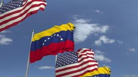 Bandiere d'ondeggiamento del Venezuela e U.S.A. sul fondo del cielo, animazione loopable 3D archivi video