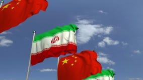Bandiere d'ondeggiamento dell'Iran e della Cina sul fondo del cielo, animazione loopable 3D stock footage