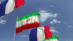 Bandiere d'ondeggiamento dell'Iran e della Francia sul fondo del cielo, animazione loopable 3D stock footage