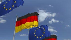 Bandiere d'ondeggiamento della Germania e l'UE sul fondo del cielo, animazione loopable 3D video d archivio