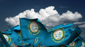 Bandiere d'ondeggiamento dello stato del Sud Dakota royalty illustrazione gratis