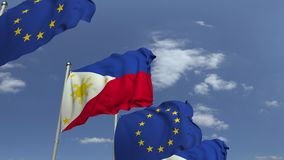 Bandiere d'ondeggiamento di Filippine e dell'Unione Europea UE, animazione loopable 3D video d archivio