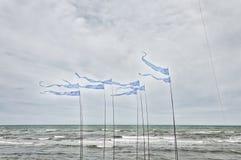 Bandiere d'ondeggiamento di forma triangolare Fotografia Stock