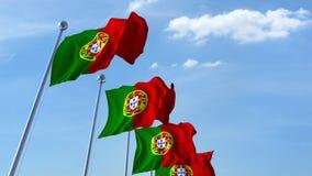 Bandiere d'ondeggiamento multiple del Portogallo contro il cielo blu archivi video