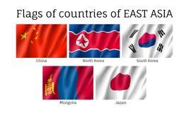 Bandiere d'ondeggiamento verso est dell'asiatico Fotografia Stock