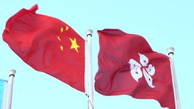Bandiere del movimento lento della Repubblica Cinese e di Hong Kong che ondeggiano nel vento stock footage