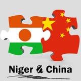 Bandiere del Niger e della Cina nel puzzle Fotografie Stock Libere da Diritti